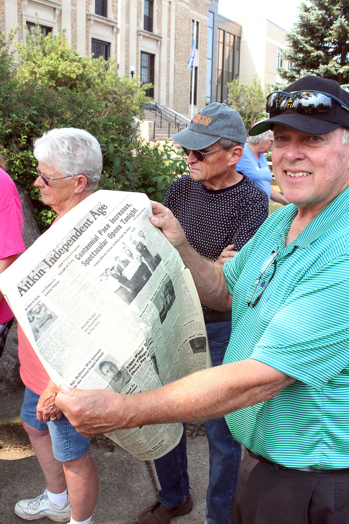 Rich Fannemel holds up the Age