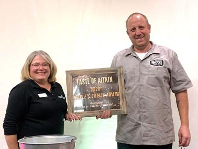 LeeAnn Moriarty presents Peter Lowe, Block North Brew Pub chef, with the People's Choice award