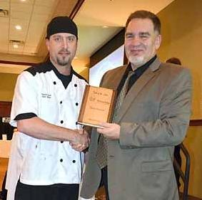 "David Downing, executive director of Kinship Partners, (right) presents Sam Shaw with his  award for ""best dessert."