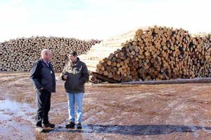 Aitkin County Commissioner Bill Pratt and Savanna Pallets Co-owner Al Raushel discuss lumber yard operations during a tour of the facility located in McGregor.
