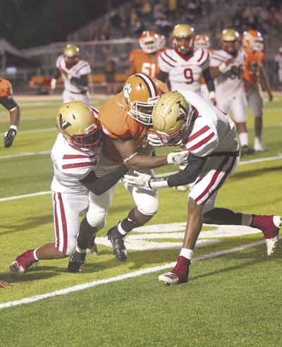 Tigers down another region rival, 21-3