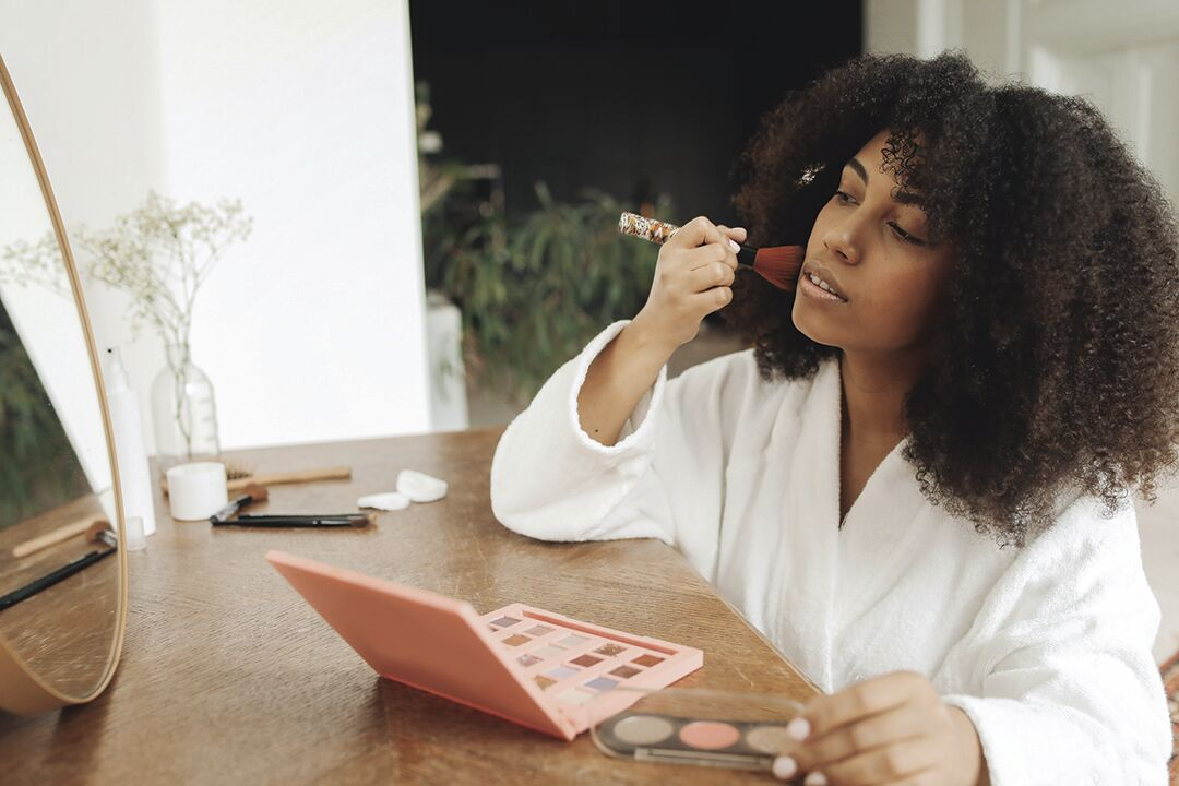 putting on makeup
