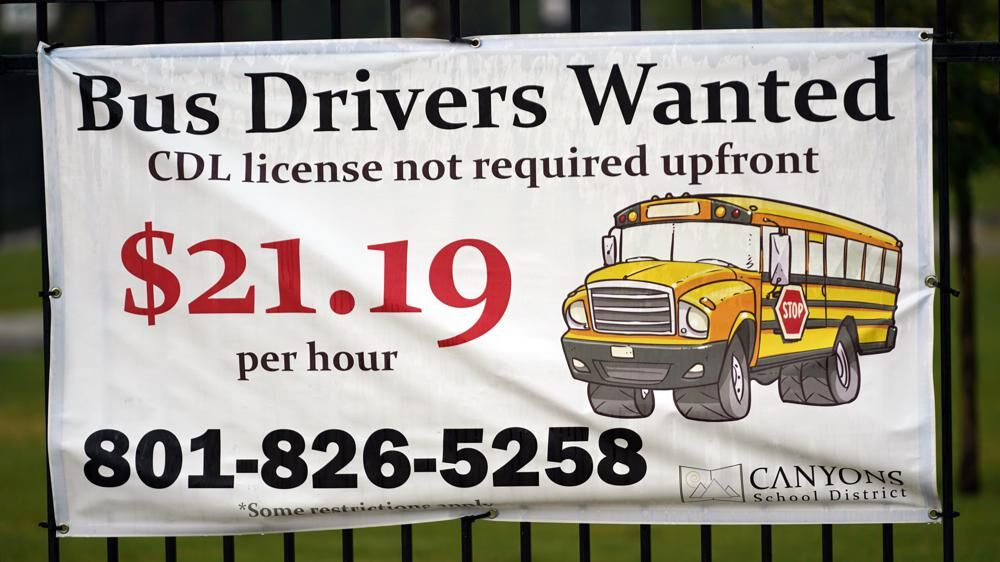 """A """"Bus Drivers Wanted"""" sign"""