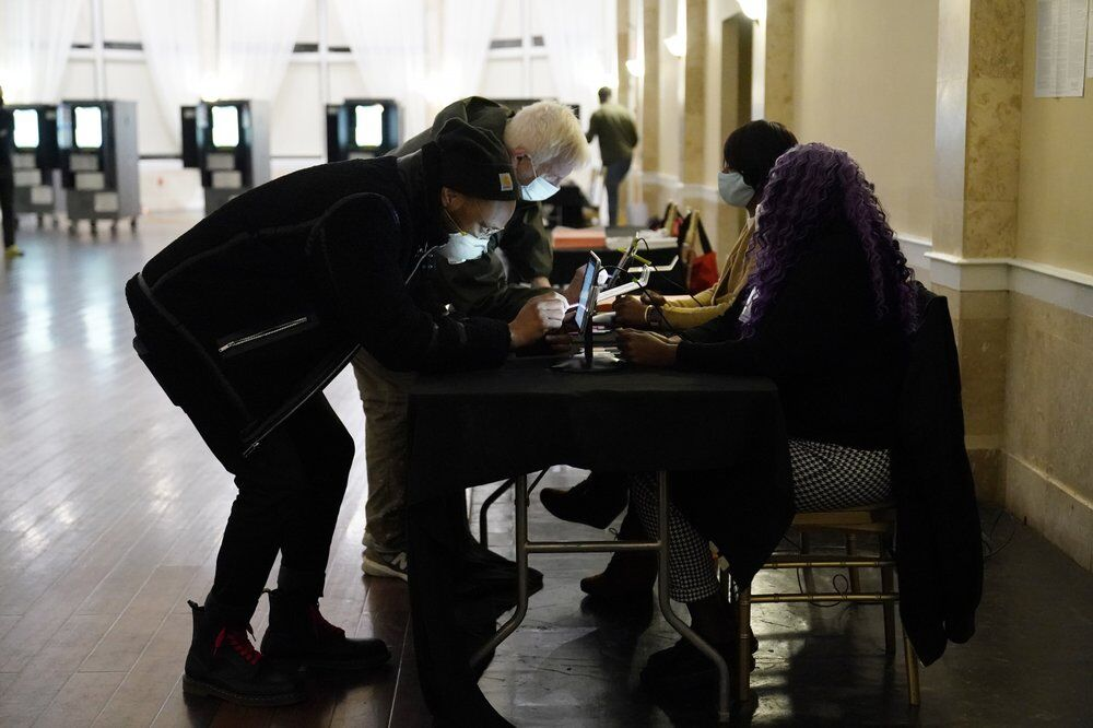 Voters register before casting their vote