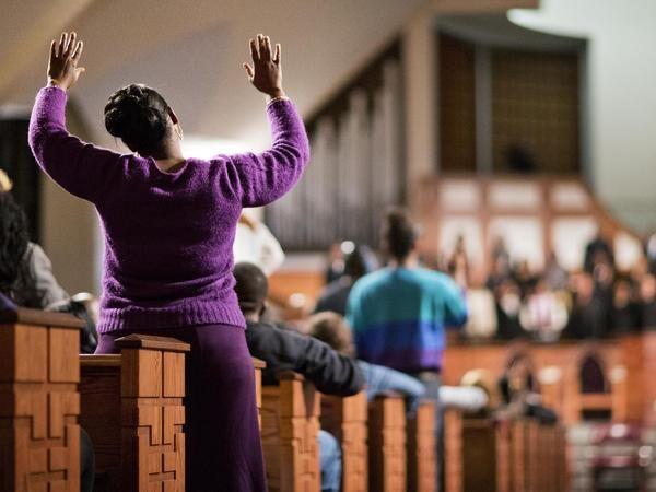 Woman raises her hands