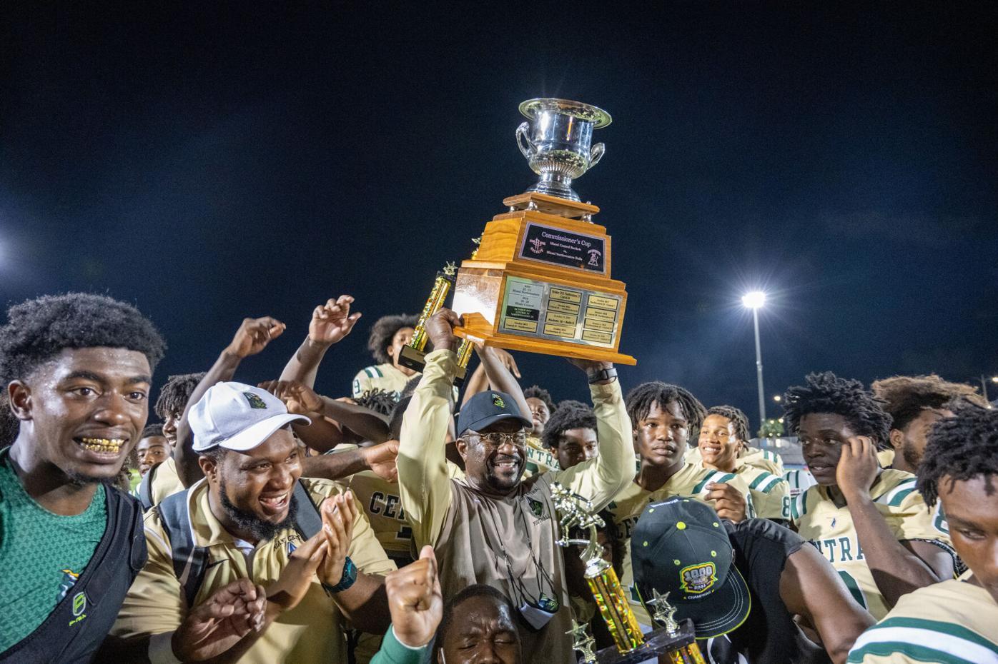 raises the Commissioner Cup trophy