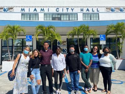 Activists pose at City Hall