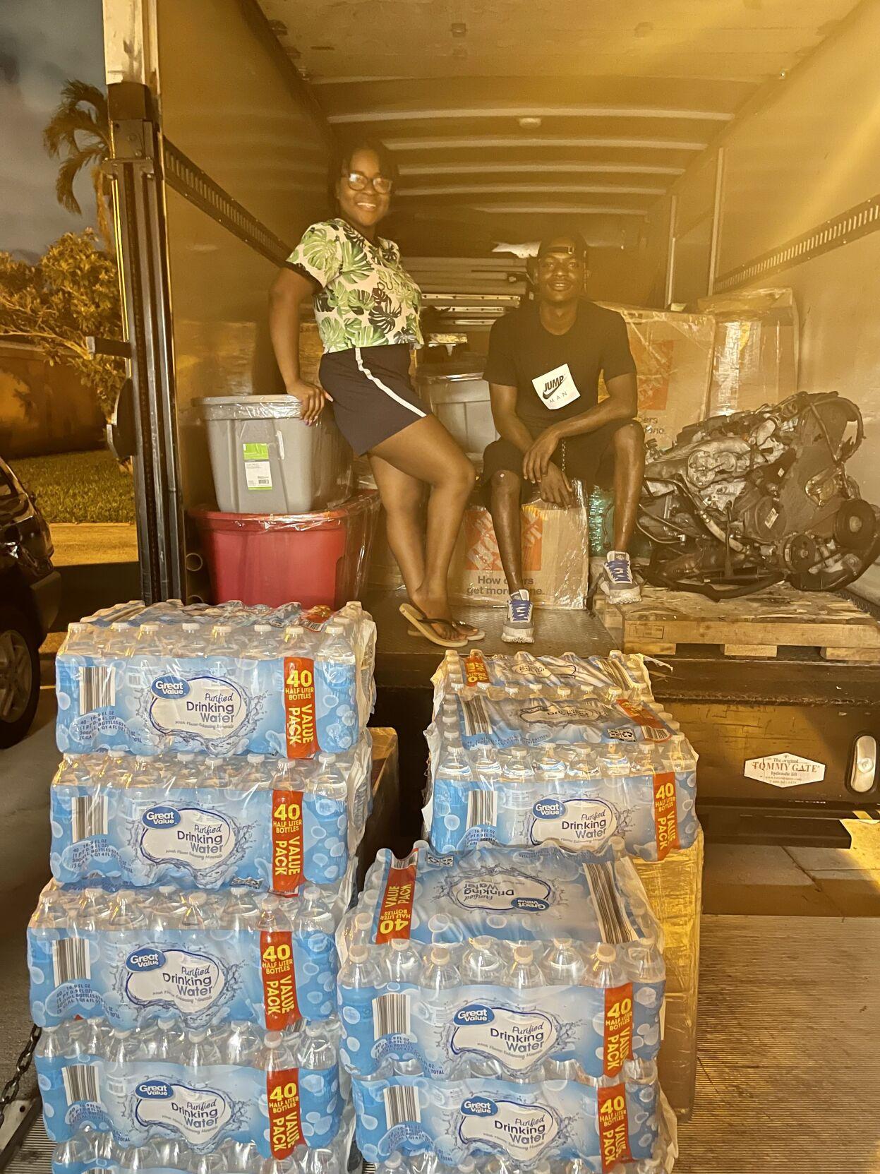Melissa Lucien packs donation