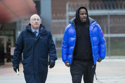 R. Kelly walks out of Cook County Jail with his defense attorney, Steve Greenberg.