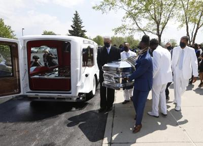 Pallbearers carrying the casket