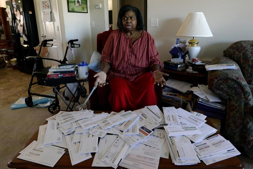 2Debra Smith with bills.jpeg