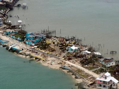Storm damaged or destroyed more than 13,000 homes, blamed for at least 20 deaths