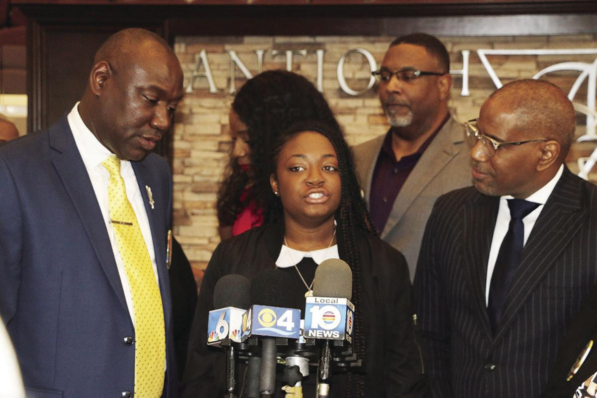 School board member shows solidarity for Kamilah Campbell during a press conference.