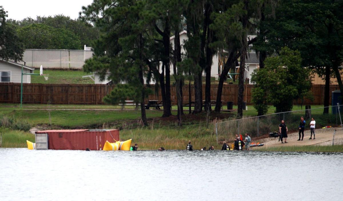 Shipping container into Lake Denton