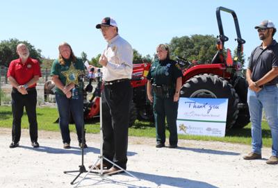Grady Column - Hope Equine Rescue tractor donation