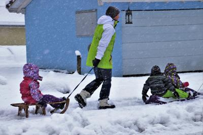 Kids in winter on sleds