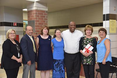 Principal congratulates retiring school staff