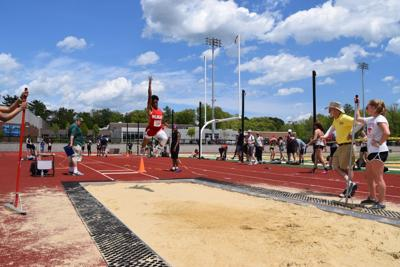Woodley competes in long jump