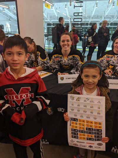 Mary Parker of the Boston Pride women's hockey team greets fans