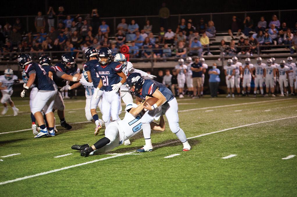 9-23 Mingo Evan Breeding making a tackle.jpg