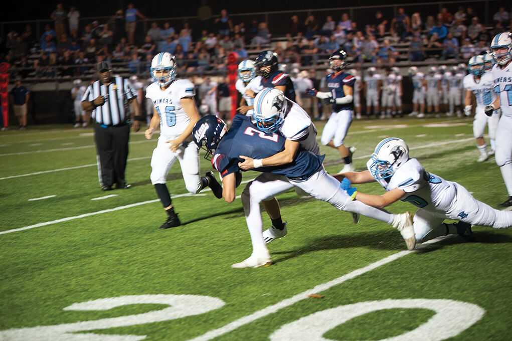 9-23 Mingo Two Miners combining on a tackle.jpg