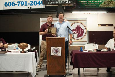 9-23 WHS Athletic Hall of Fame board member Jarrid McCormick and Blalock taking picture with Blalock's plaque.jpg