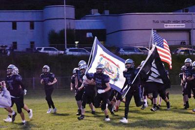 trevor tv team with flags.jpg