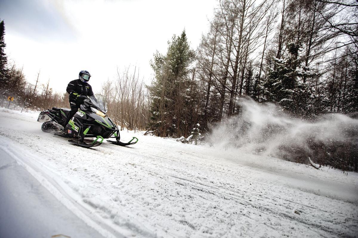 22 Snowmobile Rider on Snowmobile Trail in Eagle River.jpg