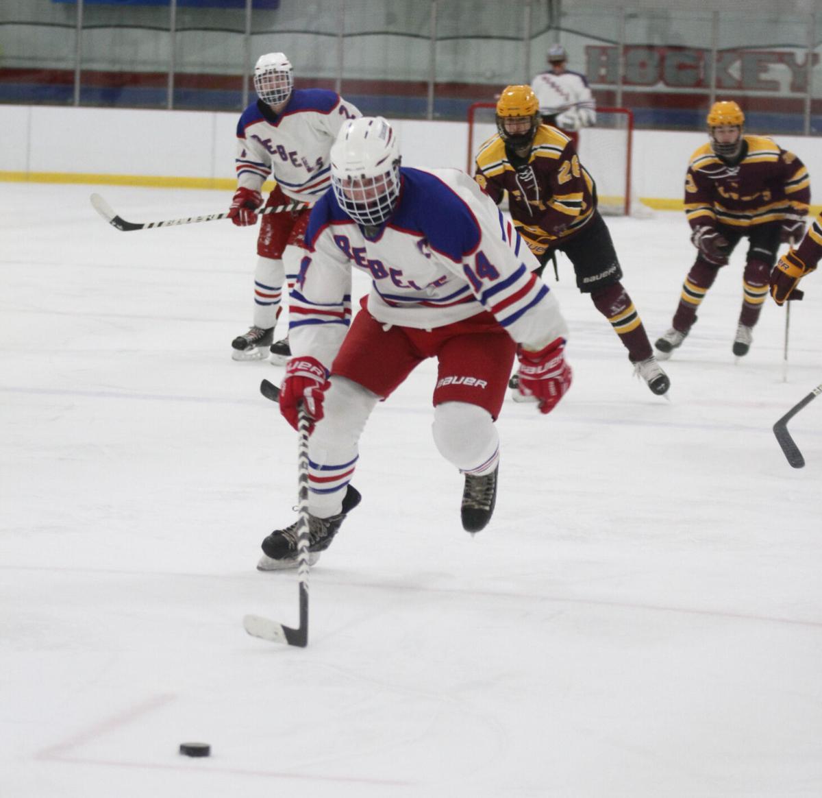 Flyers slide past Rebels Men