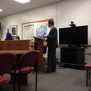 <p>Grand County Community and Economic Development Director Zacharia Levine presents the amended High Density Housing Overlay to the Grand County Council during its meeting on Jan. 15. [Photo by Rachel Fixsen / Moab Sun News]</p>