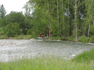 Gallatin County Sheriff's Search and Rescue help a couple to safety after boat flips
