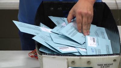 Sorting through ballot pile
