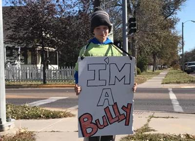 """""""I'm a Bully"""": 11-year-old boy's unconventional consequence for bullying"""