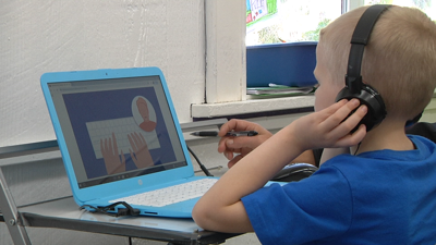 Student learns typing at Go & Grow Education Service