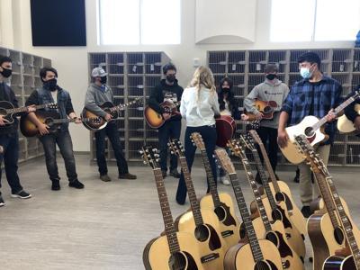 Bozeman Gibson Factory donates 24 guitars to Gallatin High School