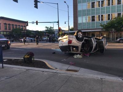 Three arrested in rollover on Broadway in downtown Missoula