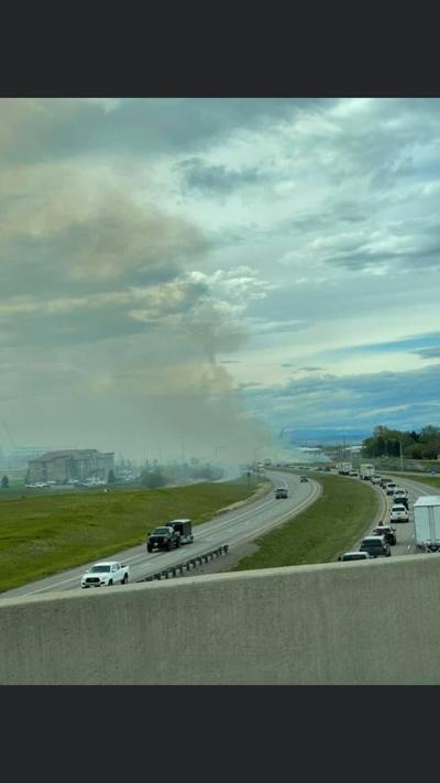 Smoke from grass fire causing low visibility