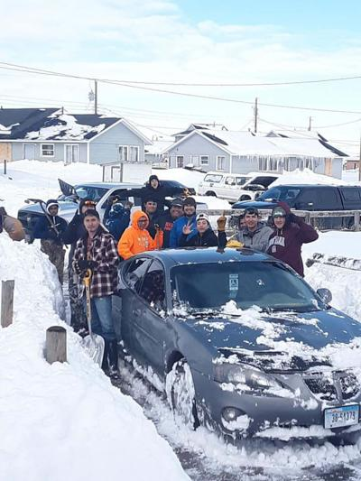 Browning football team shovels out community after September winter storm