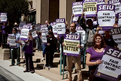 County workers ask supes to slash management perks.