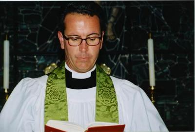 Member of St. John's Episcopal says pastor defamed her.