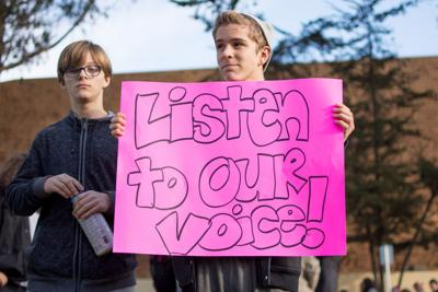A Millennium Charter High School student protests the board s decision to  put the founding principal 9bdb8d87a