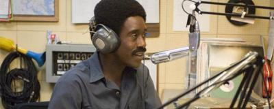 Don Cheadle plays a charismatic talk show host in