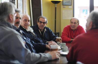A group of weathered fishermen now share coffee and stories instead of the ocean.