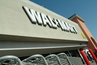 Wal-Mart foes pressure Marina to ban larger models of big box stores.