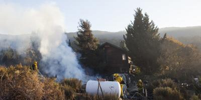 Fire in Cachagua burns three acres and destroys garage; homeowner suspects arson.