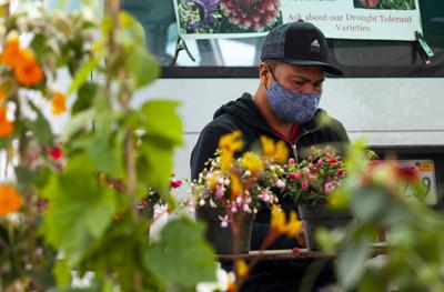 Masked flower vendor