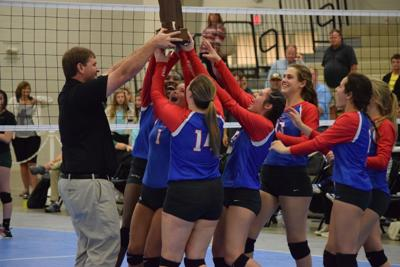 Macon east stuns Edgewood for volleyball title