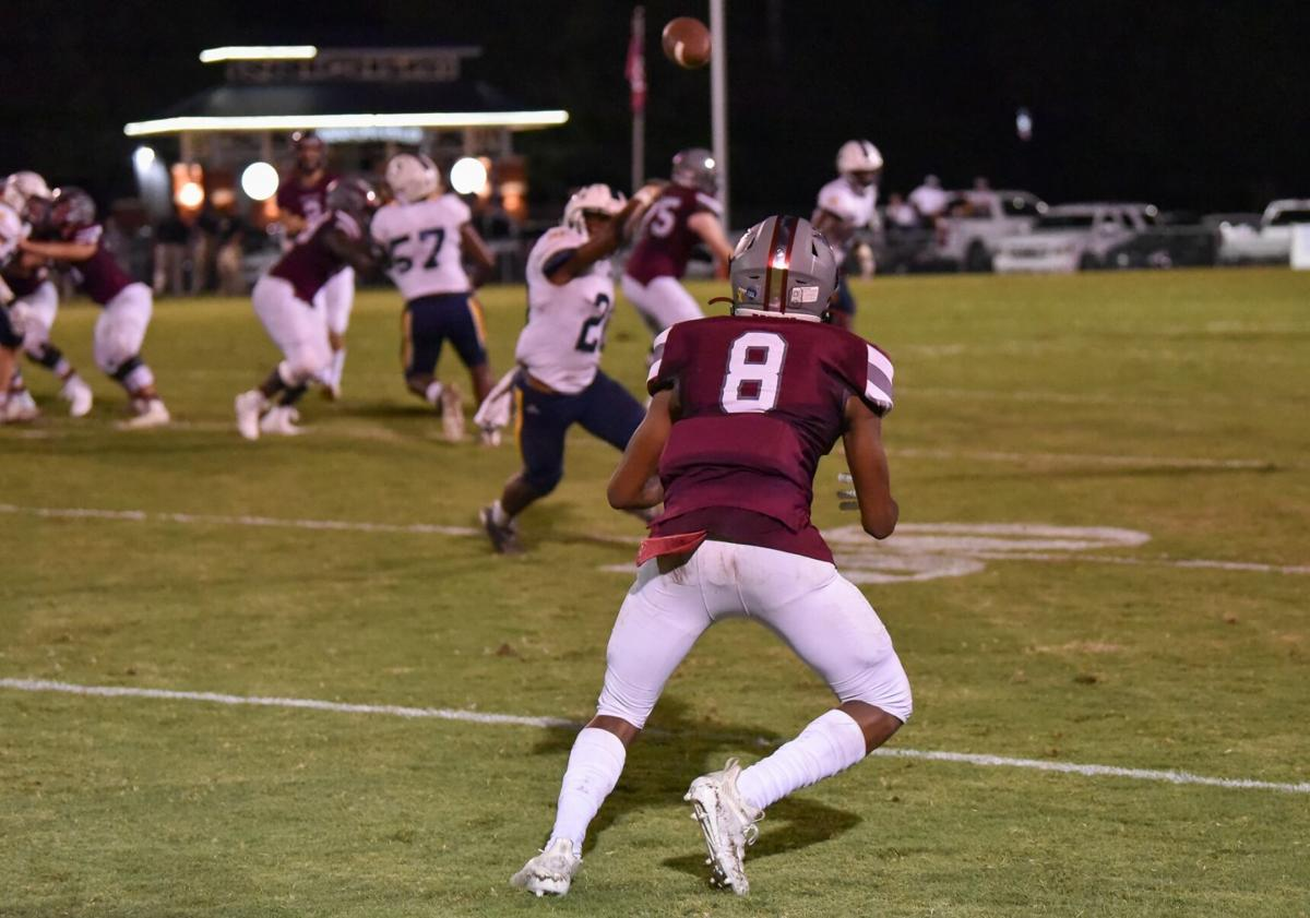 Thomas' interception gives Trojans the edge in win over ACA