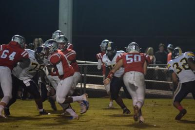 Former QB now leads Macon at center