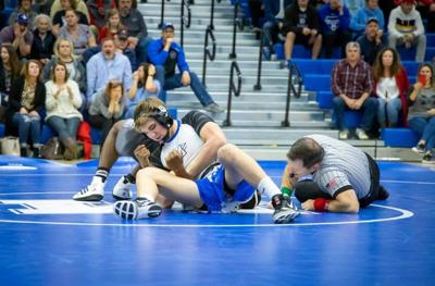 Photo: emx_20200115_mot_sports_mhswrestling_p1_Mooresville wrestlers make News with wins in Classic